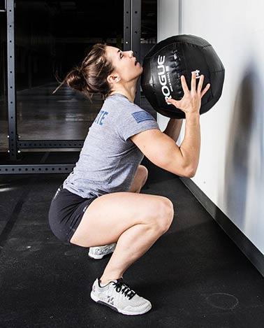 use Rogue Medicine Balls as squats