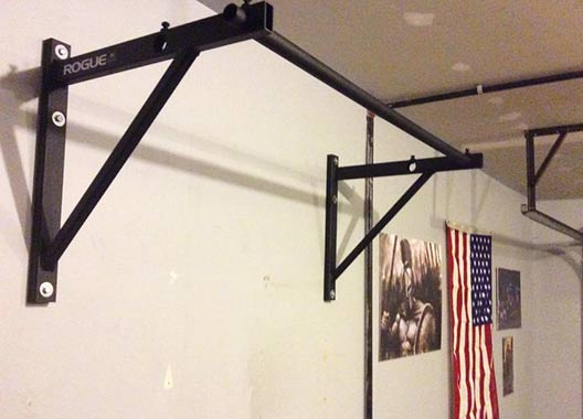 Rogue pull up bar on concrete wall